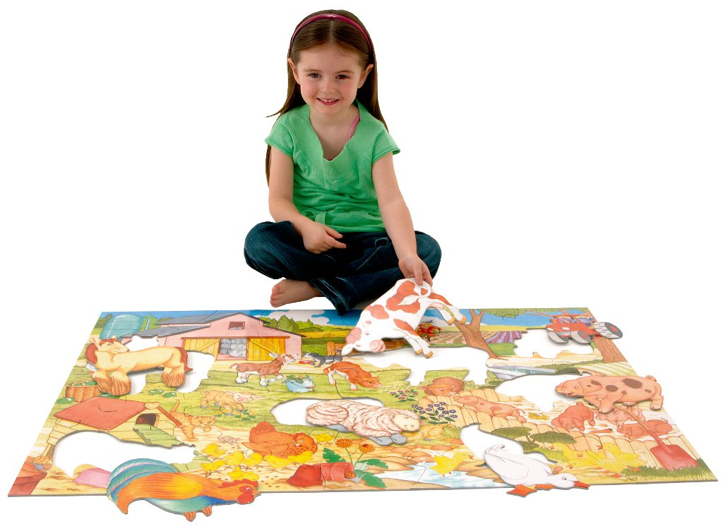 Girl making giant floor puzzle